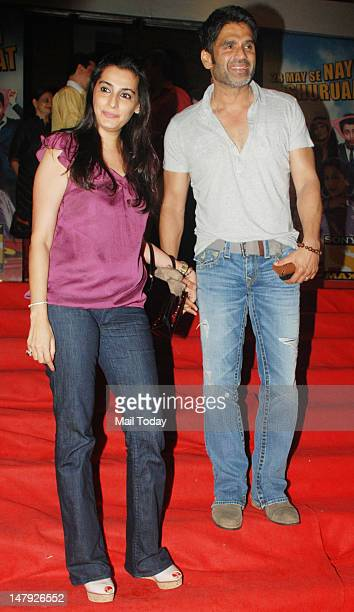 Sunil Shetty with wife Mana Shetty arrives for the screening of movie 'Bol Bachchan' held at Cinemax in Mumbai on July 5 2012