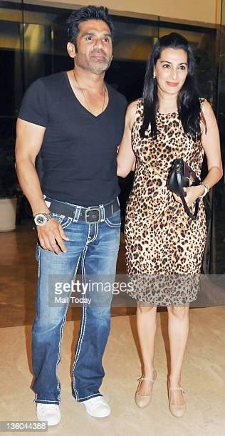 Sunil Shetty with wife Mana Shetty during Farah Khan's house warming bash in Mumbai on December 20 2011
