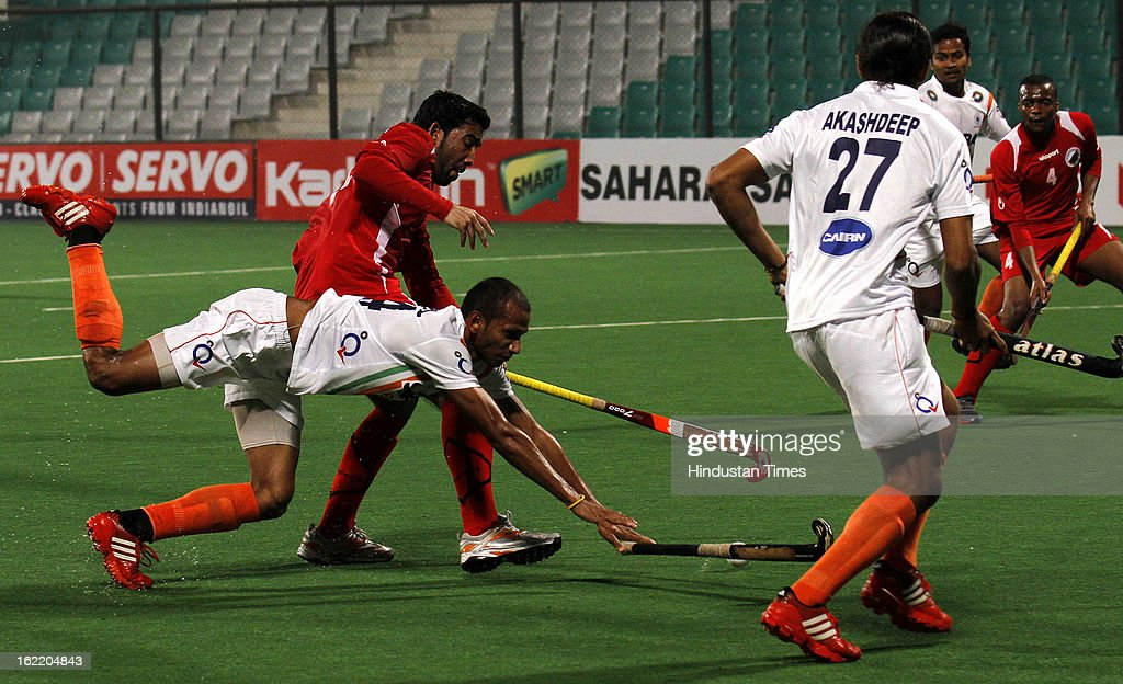 Sunil Sowmarpret of India trying to reach the ball during Hockey World League round 2 against Oman at Major Dhyan Chand stadium on February 20, 2013 in New Delhi, India. Indians mauled Oman side by 9-1.