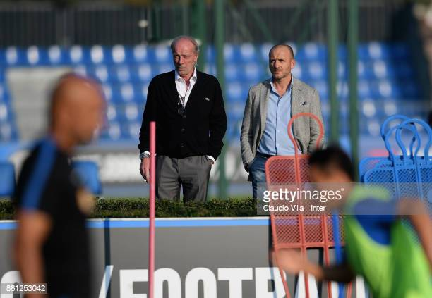 Suning Sports Technical Director Walter Sabatini and Sportif Director of FC Internazionale Milano Piero Ausilio look on during the training session...