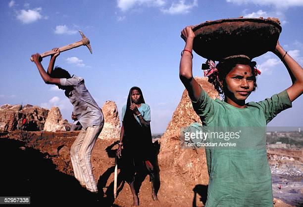 Sunita Bai carries away top soil at the Gurukul open mine near Delhi