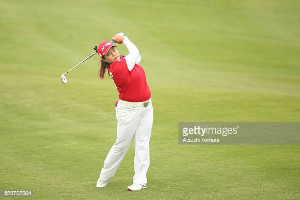SunJu Ahn of South Korea hits her second shot on the 13th hole during the final round of the Fujisankei Ladies Classic at the Kawana Hotel Golf...