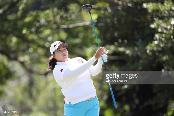SunJu Ahn of South Korea hits her tee shot on the 12th hole during the third round of the Daikin Orchid Ladies Golf Tournament at the Ryukyu Golf...