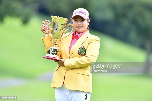 Sunju Ahn of South Korea poses with her trophy after winning the Century 21 Ladies Golf Tournament 2016 at the Izu Daijin Country Club on July 24...