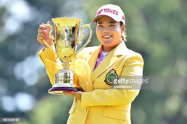 SunJu Ahn of South Korea poses with the trophy after winning the Century 21 Ladies Golf Tournament 2015 at the Izu Daijin Country Club on July 26...