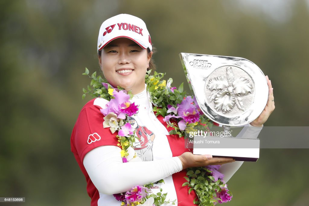 Sun-Ju Ahn of South Korea poses with the trophy after winning the Daikin Orchid Ladies Golf Tournament at the Ryukyu Golf Club on March 5, 2017 in Nanjo, Japan.