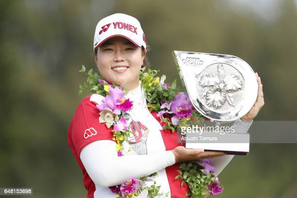SunJu Ahn of South Korea poses with the trophy after winning the Daikin Orchid Ladies Golf Tournament at the Ryukyu Golf Club on March 5 2017 in...