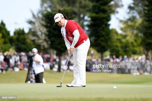 SunJu Ahn of South Korea putts to win the Daikin Orchid Ladies Golf Tournament at the Ryukyu Golf Club on March 5 2017 in Nanjo Japan