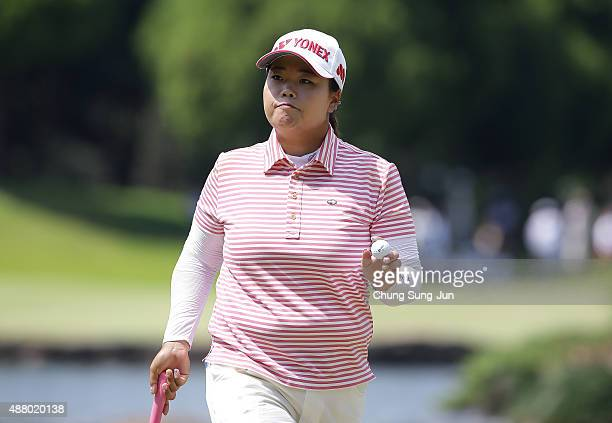 SunJu Ahn of South Korea reacts after a putt on the ninth green during the final round of the 48th LPGA Championship Konica Minolta Cup 2015 at the...