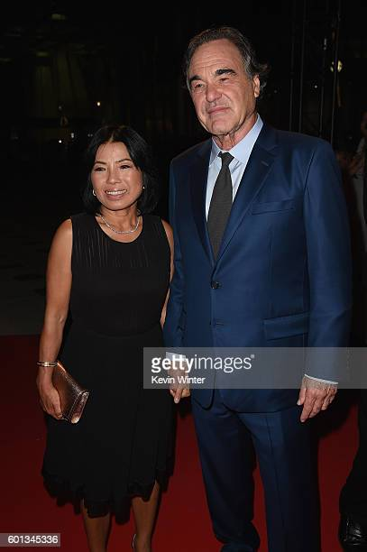 Sunjung Jung and writerdirector Oliver Stone attend the 'Snowden' premiere during the 2016 Toronto International Film Festival at Roy Thomson Hall on...