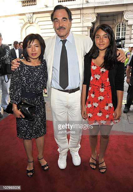 Sunjung Jung Oliver Stone and Tara Chong attend the UK Premiere of South Of The Border at the Curzon Mayfair on July 19 2010 in London England