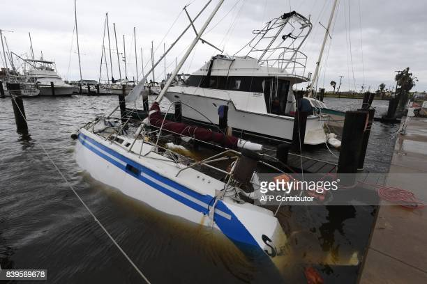 A sunken boar at Rockport Harbor after heavy damage when Hurricane Harvey hit Rockport Texas on August 26 2017 Hurricane Harvey left a trail of...