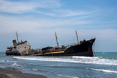 Sunken boat at beach