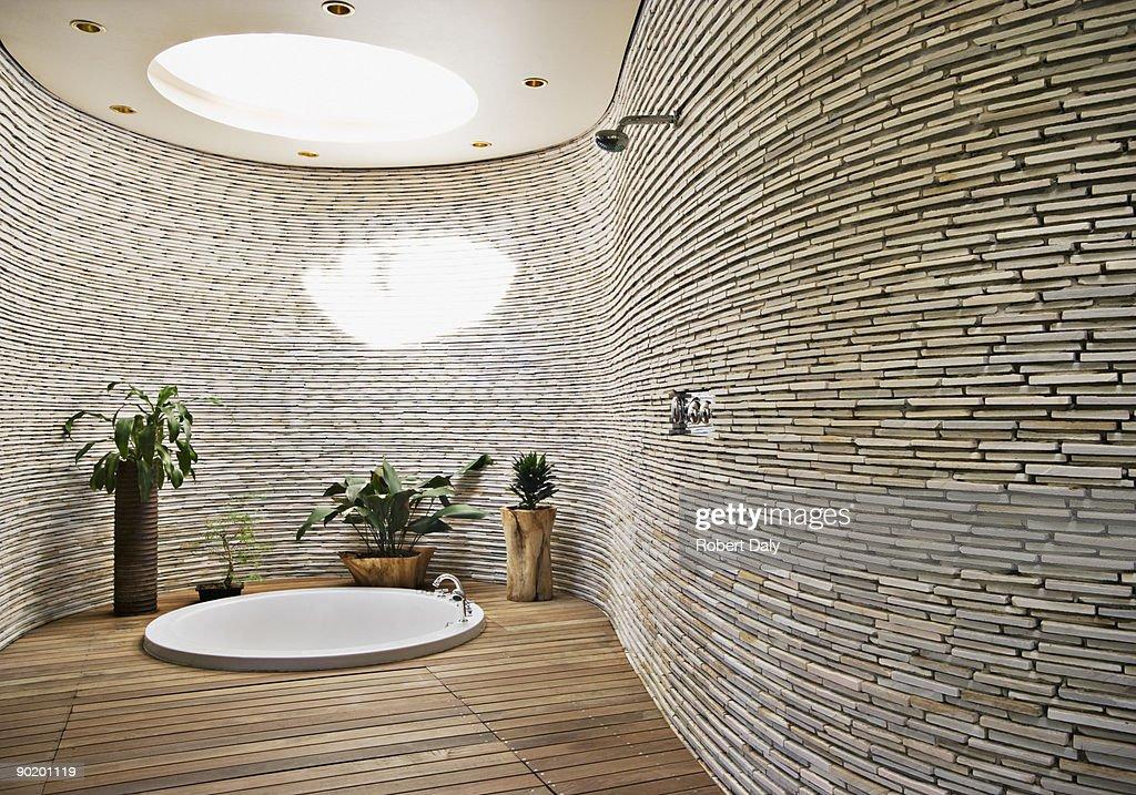 Sunken tub in modern bathroom : Stock Photo