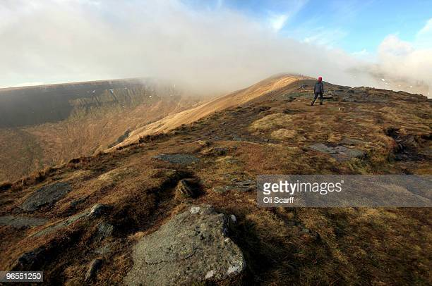 Sunlight breaks through the mist in cold conditions looking North towards the mountain 'Corn Du' in the Brecon Beacons National Park on February 6...