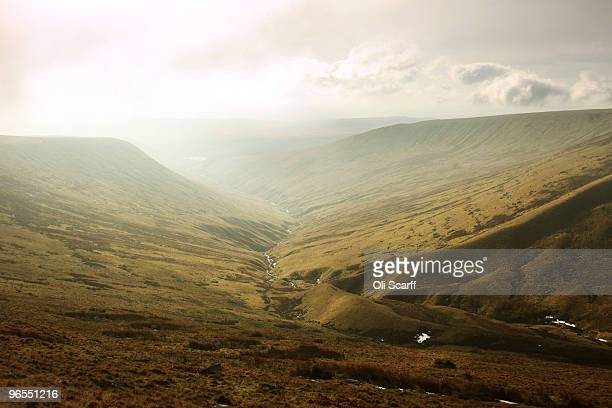 Sunlight breaks through the mist in cold conditions looking South West from the mountain 'Corn Du' in the Brecon Beacons National Park on February 6...