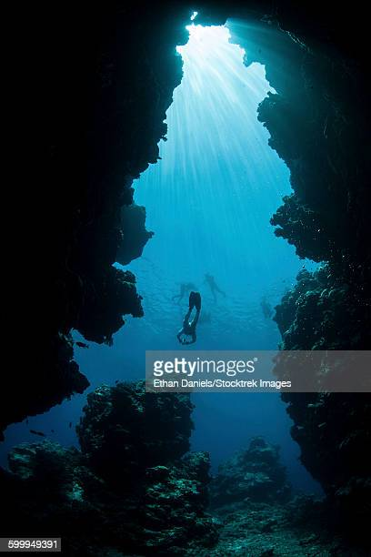 Sunlight descends underwater and into a crevice on Palaus barrier reef.