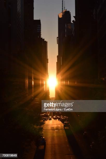 Sunlight Emitting Through Buildings In City During Sunset