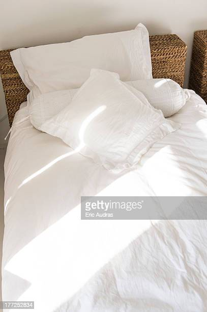 Sunlight falling on a bed
