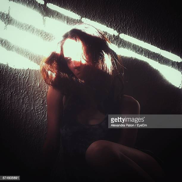 Sunlight Falling On Depressed Woman At Home