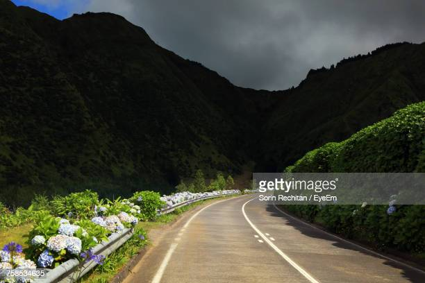 Sunlight Falling On Empty Road Against Mountains At Azores