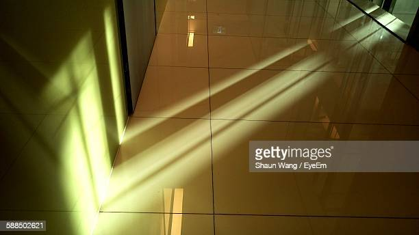 Sunlight Falling Through Ajar Door