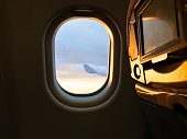 Sunlight from the porthole on airplane