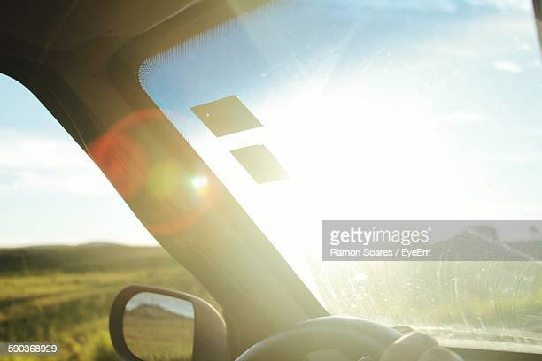 Sunlight On Car Windshield In Field