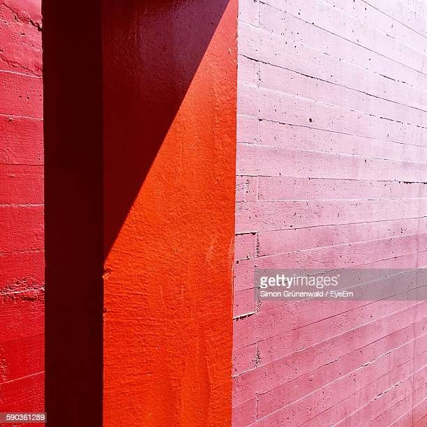 Sunlight On Red And Pink Brick Wall