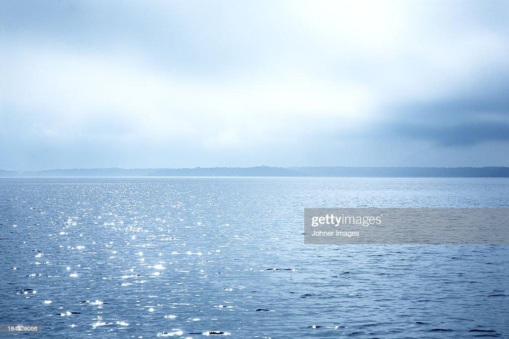 Sunlight reflecting in sea : Stock Photo