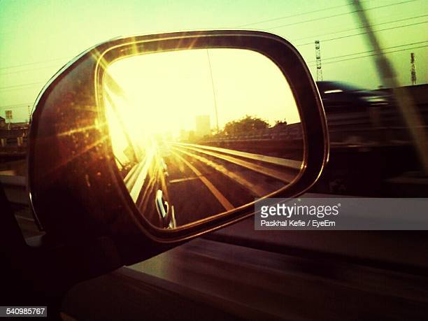 Sunlight Reflection On Side-View Mirror Of Car