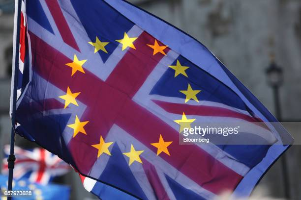 Sunlight shines through a Union flag also known as Union Jack adorned with the stars of the European Union during a Unite for Europe march to protest...