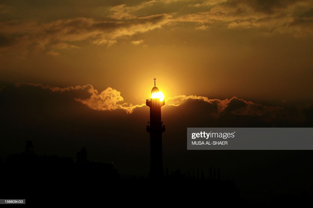 Sun-light shines through the windows of a Mosque minaret in the West Bank town of Bethlehem on December 30, 2012. Every month, Israel transfers about 460 million shekels ($120 million, 92.7 million euros) in customs duties on goods destined for Palestinian markets that transit through Israeli ports, and which constitute a large percentage of the Palestinian budget. AFP PHOTO / MUSA AL-SHAER