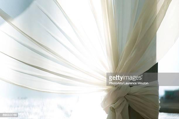 Sunlight shining through translucent fabric