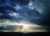 Sunlight Streaming Through Storm Clouds