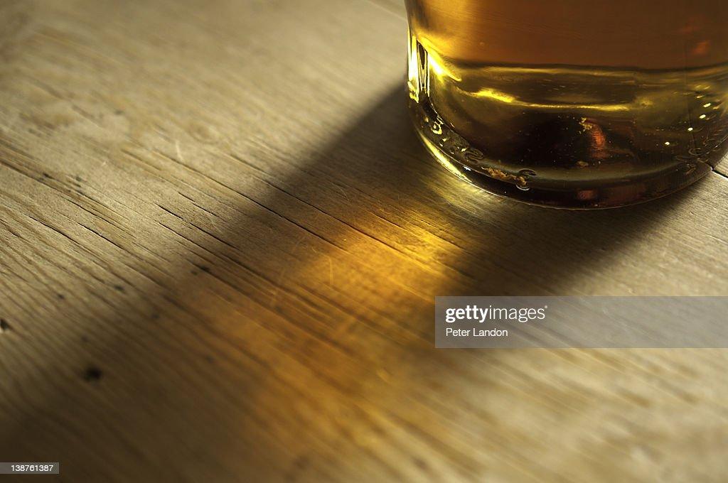 Sunlight through a whisky bottle : Stock Photo