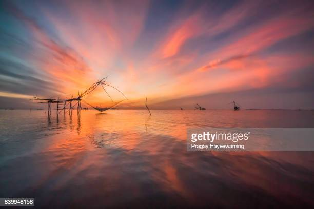 Sunlight :Yor building is traditional local fisherman used net fishing in Pakpra Thale Noi, one of the country's largest wetlands covering Phatthalung, Nakhon Si Thammarat and Songkhla ,South of Thailand.
