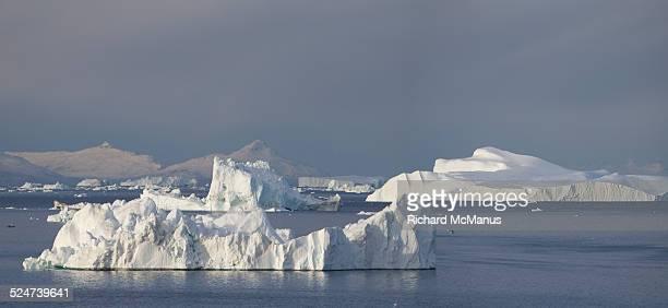 Sunlit icebergs in Disko Bay