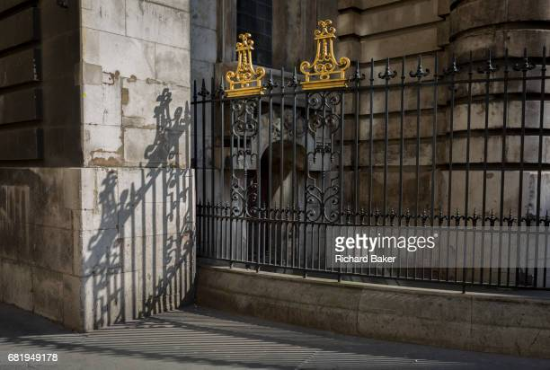 Sunlit railings of St Mary Woolnoth church on Lombard Street on 10th May 2017 in the City of London England St Mary Woolnoth is an Anglican church in...