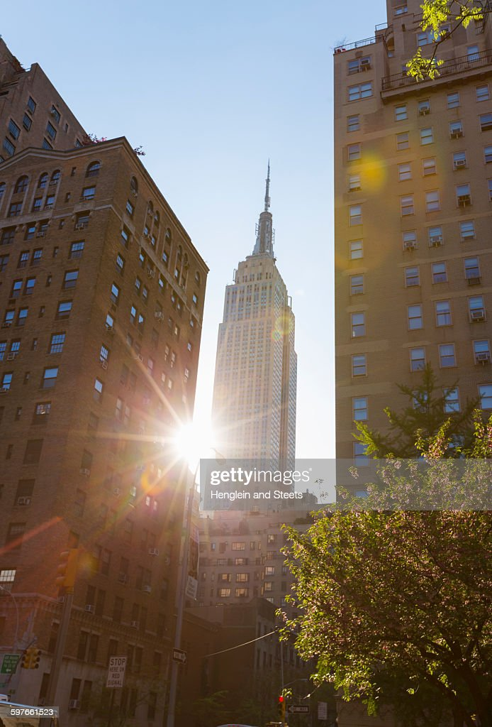 Sunlit view of Empire State building from Park Avenue, New York, USA
