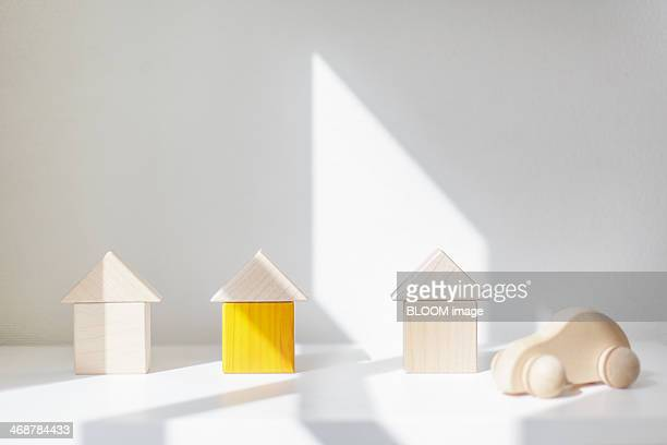 Sunlit wooden model houses and toy car
