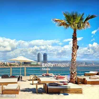 Sunloungers on beach in Barcelona, Spain