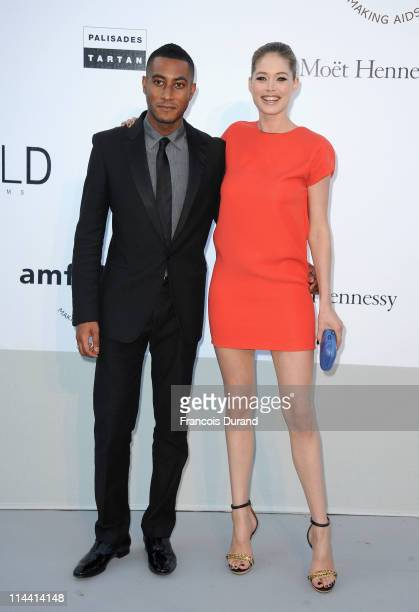 Sunnery James and Doutzen Kroes attend amfAR's Cinema Against AIDS Gala during the 64th Annual Cannes Film Festival at Hotel Du Cap on May 19 2011 in...