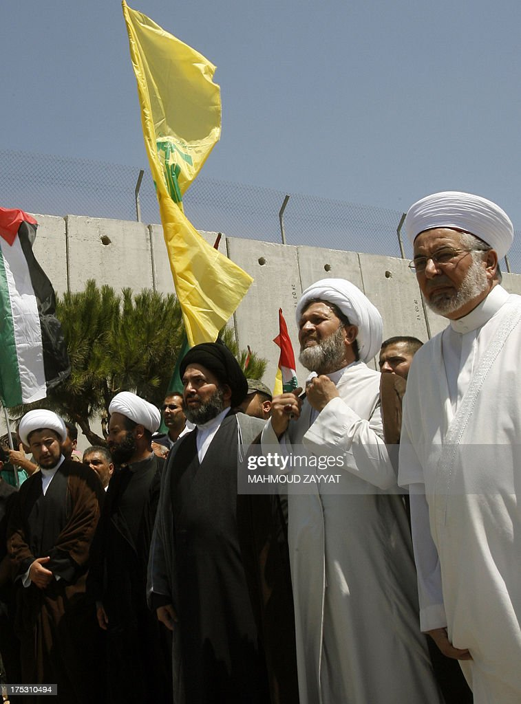 Sunni and Shiite religious officials take part in a march in the southern Lebanese village of Kfar Kila, on August 2, 2013, to mark the 'Al-Quds (Jerusalem) International Day'. An initiative started by Iranian revolutionary leader Ayatollah Ruhollah Khomeini, Quds Day is held annually on the last Friday of the Muslim fasting month of Ramadan and calls for Jerusalem to be returned to the Palestinians.