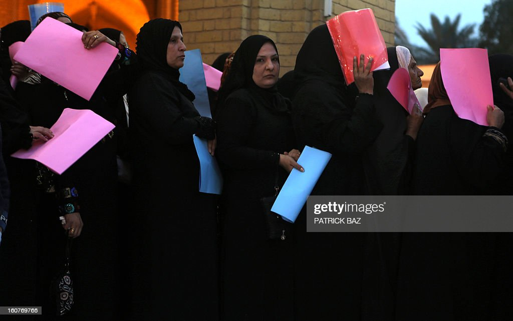 Sunni Iraqi women gather outside the Abu Hanifa mosque in Baghdad's Sunni stronghold of Adhamiya on February 05, 2013 to meet with an Iraqi officials about the faith of their detained relatives. A top Iraqi minister said that the authorities had released 3,000 prisoners over the past month in a bid to appease weeks of angry demonstrations in Sunni-majority areas of the country.