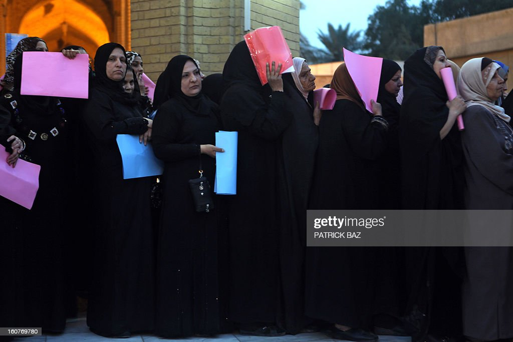 Sunni Iraqi women gather outside the Abu Hanifa mosque in Baghdad's Sunni stronghold of Adhamiya on February 05, 2013 to meet with an Iraqi officials about the faith of their detained relatives. A top Iraqi minister said that the authorities had released 3,000 prisoners over the past month in a bid to appease weeks of angry demonstrations in Sunni-majority areas of the country. AFP PHOTO/PATRICK BAZ