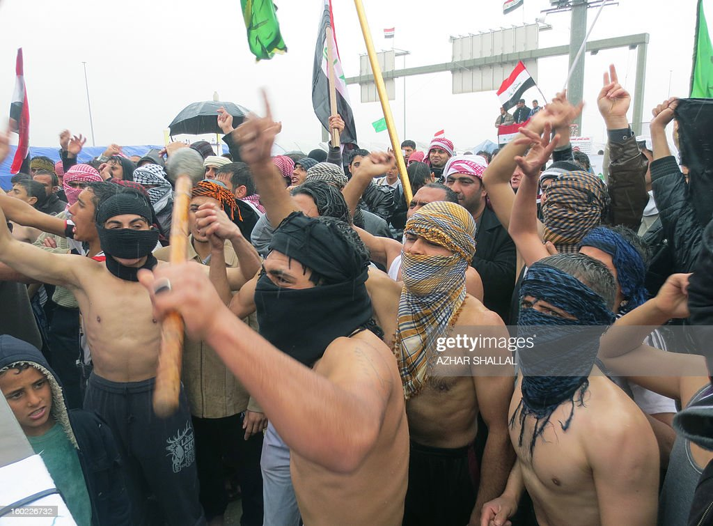 Sunni Muslims in the western Iraqi city of Ramadi, on January 28, 2013, calling for their rights. The protests came after lawmakers opposed to Prime Minister Nuri al-Maliki adopted a measure that could bar him from holding office beyond next year after weeks of angry rallies in mostly-Sunni areas against the Shiite premier's rule.
