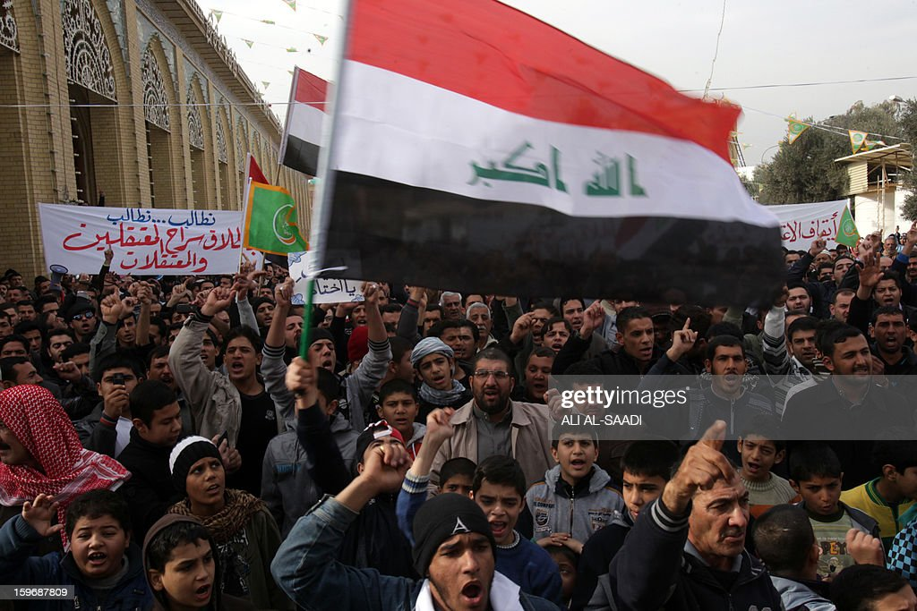 Sunni Muslims shout slogans and wave the Iraqi flag as they take part in an anti-government demonstration outside the Sunni Abu Hanifa mosque in Baghdad's Adhamiyah district on January 18, 2013. Tens of Iraqi Sunni Muslims took to the streets in Baghdad and other cities after Friday prayers, in another show of discontent with Shiite Prime Minister Nuri al-Maliki.