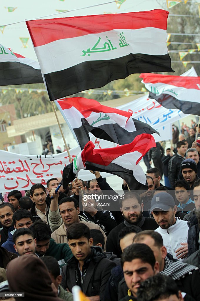 Sunni Muslims wave the old Iraqi flag used between 1991-2004 as they take part in an anti-government demonstration outside the Sunni Abu Hanifa mosque in Baghdad's Adhamiyah district on January 18, 2013. Tens of Iraqi Sunni Muslims took to the streets in Baghdad and other cities after Friday prayers, in another show of discontent with Shi'ite Prime Minister Nuri al-Maliki. AFP PHOTO / ALI AL-SAADI