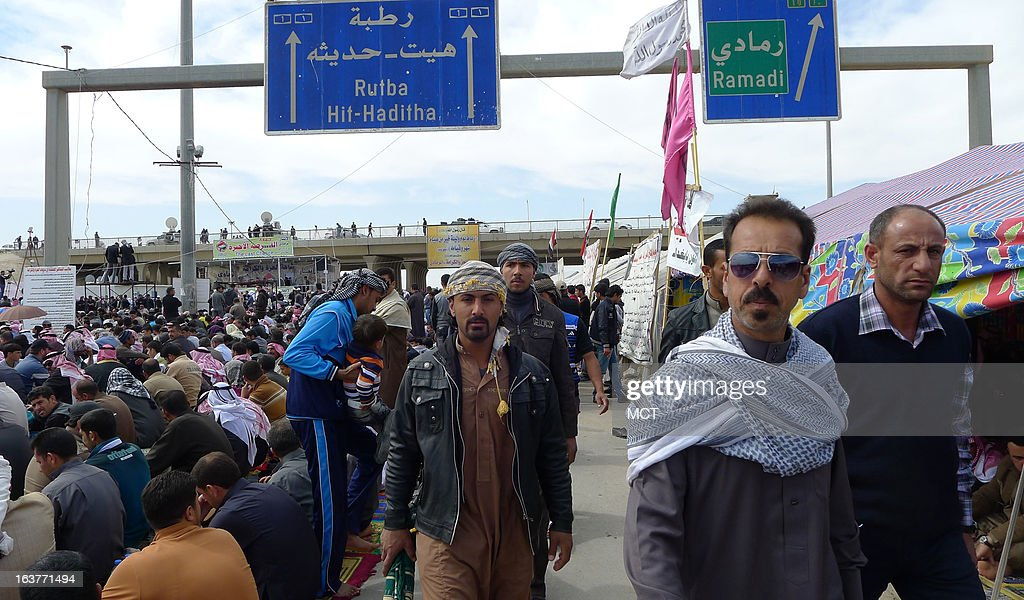 Sunni protesters arrive for a Friday prayer service on Iraq's main highway to Jordan. The protest againsts the Shiite-led government in Baghdad began at the start of the year and blocks the roadway.